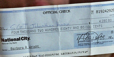 Counterfeit cheque used in phtographer scam